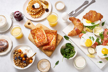 Healthy Sunday Breakfast With Croissants, Waffles, Eggs, Granola And Sandwiches
