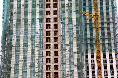 Obraz na płótnie Hydraulic luffing jib tower cranes being poured concrete into foundation