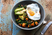 Fried Egg With Avocado And Kale Butternut Squash Hash