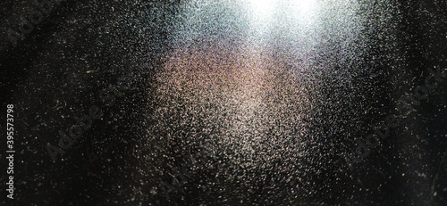 Foto Light beam on black background with sparkles, radiance and sparkles
