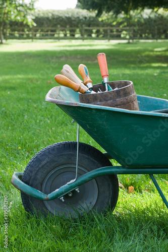 Vászonkép Wheelbarrow With Gardening Tools