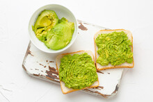 Homemade Avocado Toasts And Smashed Fresh Ripe Avocados In Bowl