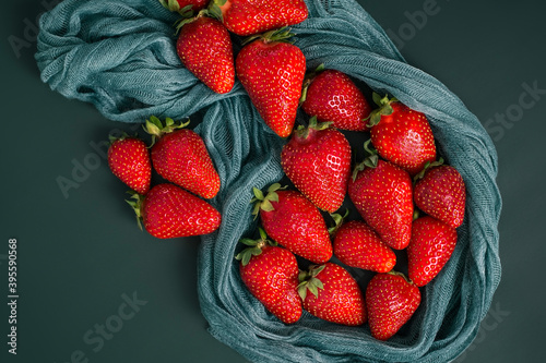 Fotografie, Obraz Red strawberries beautifully laid out on a thin gauze cloth
