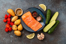 Raw Salmon Fish Fillet, Fresh Vegetables And Herbs - Ingredients For Cooking Healthy Meal