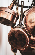 Copper Pots In The Kitchen On A Hanging Wreath