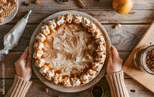 Flat lay of a served yummy pumpkin cheesecake and its ingredients Fototapet