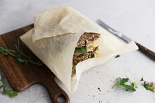 Wholegrain Sandwiches With Cheese Wrapped In Paper