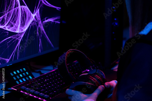 Fototapeta purple, blue and pink set up gamer with a keyboard and monitor belonging to a gi