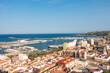 Denia cityscape, harbor (port) and seascape. Aerial view from the historic moorish castle mirador. Costa Blanca, Valencian community, Spain.