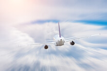 Airplane Flies Over Cumulus Cl...