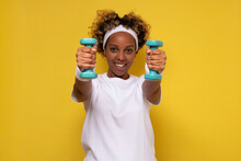 Healthy And Strong African American Female Athlete, Exercising With Dumbbells