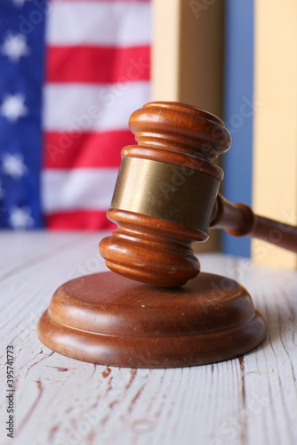 Photo Closeup of gavel and book against american flag