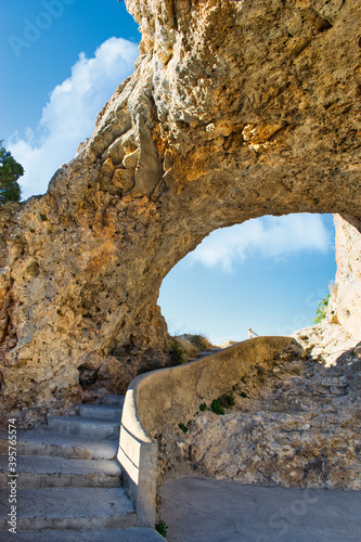 Staircase under arch and bridge of natural rock formation in the viewpoint of el Canvas Print