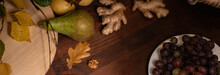 Panoramic Banner. Close Up Top View Of A Fruits, Grapes, Ginger Root On A Wooden Table. Wine Snacks Set: Selection Of Cheese, Grapes, Pear And Walnuts On A Wooden Board.