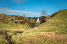 A Winter HDR Image Of Cray Gill Waterfall As The Water Tumbles Over The Cliff Edge, Near Cray, North Yorkshire, England.