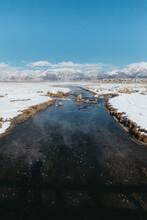 Hot Creek In Winter Landscape Of Eastern Sierra, California