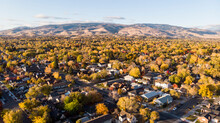 Drone  Photo Of Reno Neighborhoods During The Fall Sesason Looking Towards The Mountains.