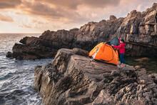Female Setting Up Tent Foe Cam...