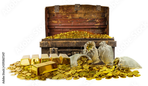 Fotografia A lot of stacking gold coins in treasure stack and gold bar 1kg on white backgro