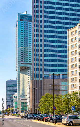 Obraz Intercontinental Hotel tower and Skylight Zlote Tarasy Tower at Emili Plater street in downtown Srodmiescie district in city center of Warsaw, Poland - fototapety do salonu