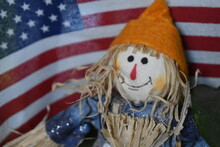 Scarecrow With American Flag Background