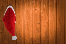 Santa's Hat Hanging On His Workshop Wall With Coy Space
