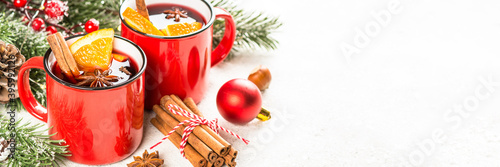 Mulled wine. Traditional christmas and winter drink with red wine, citrus and spices. Long banner format.