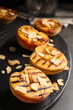 Delicious grilled peaches with almond flakes on grey table, closeup