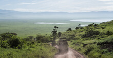 Safari Truck Driving Into The Ngorongoro Crater With View Over The Lakes