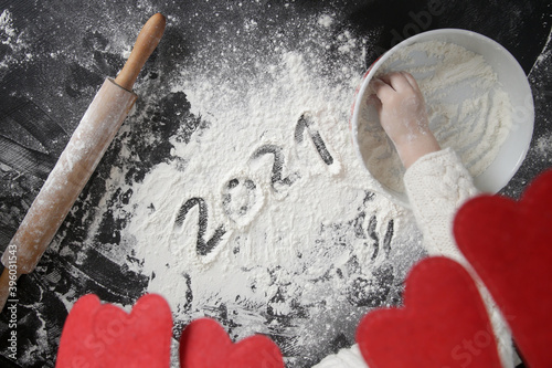Fototapeta 2021 written on flour on the table  obraz