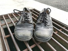 Worn Out Man's Black Leather Shoe.