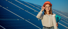 Businesswomen Working On Checking Equipment At Solar Power Plant With Tablet Checklist, Woman Working On Outdoor At Solar Power Plant