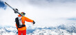 Leinwandbild Motiv Panoramic portrait of a stern climber skier in sunglasses and a cap with a ski mask on his face. holds his skis on his shoulder and looks away against of Mount Elbrus