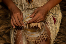 Hands Of Indigenous Woman From The Huitoto Tribe Of The Colombian Amazon Making Traditional Weaving Of A Basket