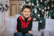 Christmas- Child In Front Of Christmas Tree