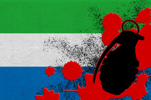Sierra Leone Flag And MK2 Frag Grenade In Red Blood. Concept For Terror Attack Or Military Operations With Lethal Outcome