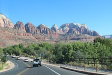 An Array Of Mountains Up There And Of Cars Down Below, Zion National Park, Utah.