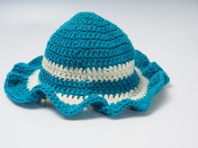 Blue With White Strip Crochet Hat On An Isolated Background
