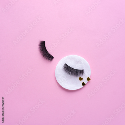 Obraz na plátne Creative concept beauty fashion photo of lashes extensions brush on pink background