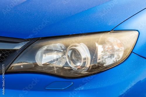 Fototapeta 自動車のヘッドライト Headlight of the old car obraz na płótnie