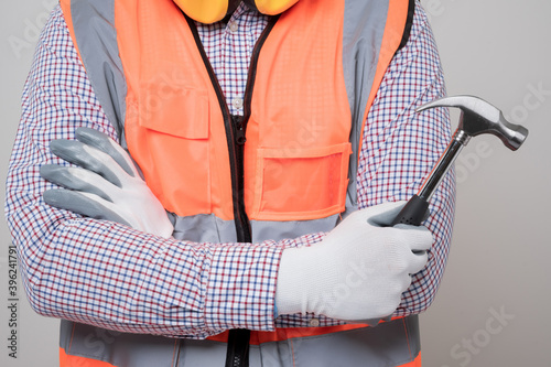 Fotografie, Obraz Close up hand of craftsman holding hammer on isolated white background