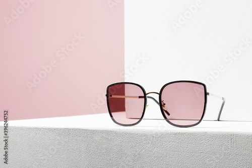 Fototapeta fashion still life. female sunglasses on withe cube obraz