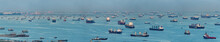 Wide Panorama Image Of Container Ships And Tankers Anchored At The Singapore Strait.