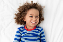 Portrait Of Joyful Young Boy With Curly Hair