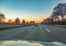 German Highway In The Evening With Cars Speeding Without Speed Limit