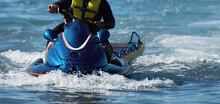 Lifeguard On A Jet Ski Patrols The Beach An Ocean Safety Lifeguard Riding A Jet Ski