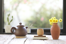 Oriantal Clay Teapot With Cup And Pot Of Flower Yellow Chrysanthemum