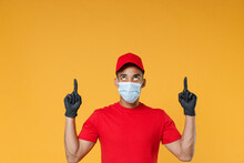 Delivery Employee African Man In Red Cap Blank Print T-shirt Face Mask Gloves Uniform Work Courier Dealer Service On Quarantine Coronavirus Covid-19 Virus Concept Isolated On Yellow Background Studio.