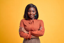 Advertising Concept. Confident And Smiling Young African American Woman Crossed Hands On Chest, Looking At Camera And Standing On Yellow Copy Space Background.