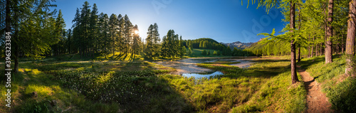Fototapeta Sunset in the Queyras Nature Park with Lac de Roue lake late Spring -early Summer (panoramic). Arvieux, Hautes-Alpes, French Alps, France obraz